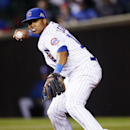 Chicago Cubs shortstop Starlin Castro throws to first base for an out against Arizona Diamondbacks' Tony Campana during the seventh inning of a baseball game on Monday, April 21, 2014, in Chicago The Associated Press