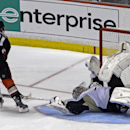 Pittsburgh Penguins goalie Marc-Andre Fleury (29) goes sprawling to block a shot by Anaheim Ducks right winger Kyle Palmieri (21) in a shootout in an NHL hockey game in Anaheim, Calif., Friday, March 7, 2014. The Penguins won the shootout, 3-2 The Associ
