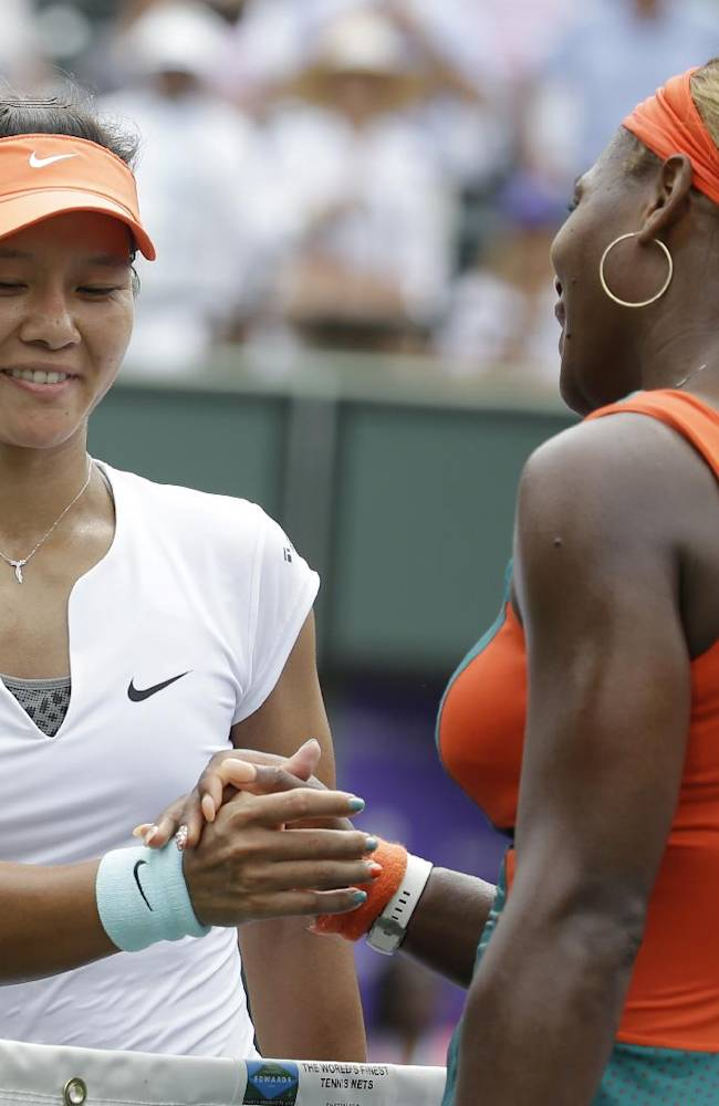 Serena Williams, right, shakes hands with Li Na, of China, after Williams won the women's final 7-5, 6-1 at the Sony Open Tennis tournament, Saturday, March 29, 2014, in Key Biscayne, Fla