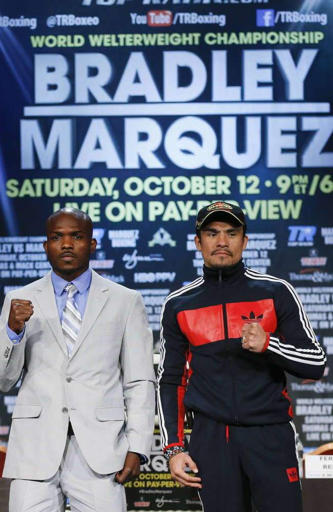 Boxers Timothy Bradley, left, and Juan Manuel Marquez pose for photos after a news conference, Wednesday, Oct. 9, 2013, in Las Vegas. Bradley is scheduled to defend his WBO welterweight title against Marquez on Saturday