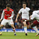 Arsenal's Olivier Giroud, left, gets the ball from Aston Villa's Jores Okore, right, during the English Premier League soccer match between Arsenal and Aston Villa at the Emirates stadium in London, Sunday, Feb. 1, 2015