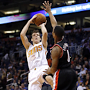Phoenix Suns' Goran Dragic (1), of Slovenia, shoots over Portland Trail Blazers' Damian Lillard during the second half of an NBA basketball game, Wednesday, Nov. 27, 2013, in Phoenix The Associated Press