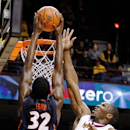 Illinois' Nnanna Egwu (32) dunks the ball over Minnesota's Trevor Mbakwe (32) during the first half of an NCAA college basketball game, Sunday, Feb. 10, 2013, in Minneapolis. (AP Photo/Genevieve Ross)