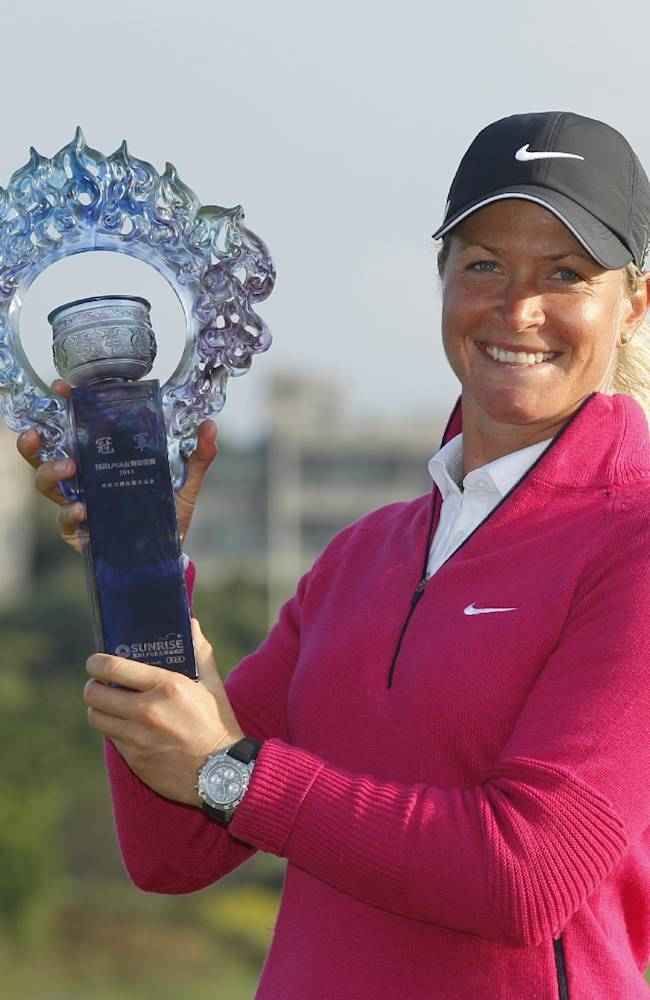 Suzann Pettersen of Norway, holds her trophy for media after winning the LPGA Taiwan Championship tournament at the Sunrise Golf & Country Club, Sunday, Oct. 27, 2013, in Yangmei, northern Taiwan. Pettersen held off a furious rally Sunday from Azahara Munoz to win her second consecutive Taiwan Sunrise LPGA championship