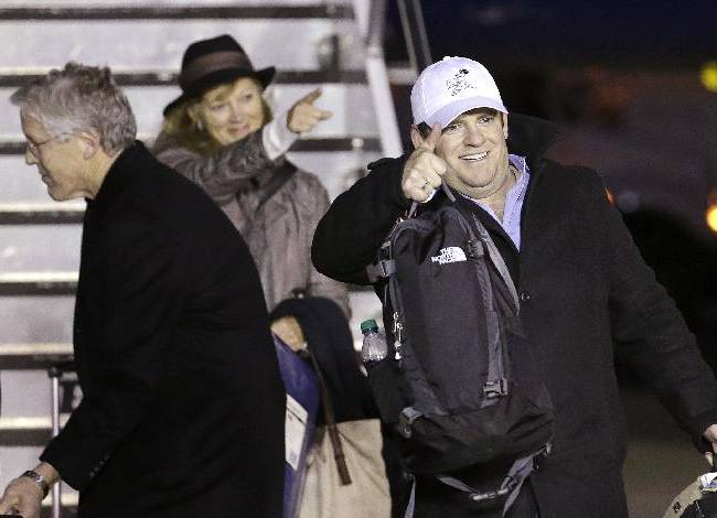 Seattle Seahawks general manager John Schneider, gives a thumbs-up to fans on the team's arrival Monday, Feb. 3, 2014, at Seattle-Tacoma International Airport in Seattle. The Seahawks beat the Denver Broncos 43-8 in the Super Bowl on Sunday