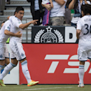 Vancouver Whitecaps' Sebastian Fernandez, second left, of Uruguay, and Mauro Rosales, right, of Argentina, celebrate Fernandez's first goal against FC Dallas during the first half of a soccer game in Vancouver, British Columbia., on Saturday Oct. 4, 2014