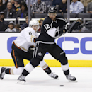 Los Angeles Kings right wing Marian Gaborik, right, draws a hooking penalty from Anaheim Ducks defenseman Ben Lovejoy during the second period of an NHL hockey game in Los Angeles, Saturday, March 15, 2014 The Associated Press