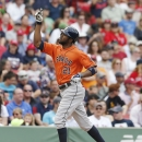 In this Aug. 17, 2014, file photo, Houston Astros' Dexter Fowler celebrates his solo home run during the third inning of a baseball game against the Boston Red Sox in Boston. Outfielder Dexter Fowler has been traded from the Astros to the Chicago Cubs, Mo