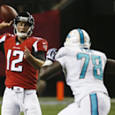 In this Aug. 8, 2014, file photo, Miami Dolphins defensive end Terrence Fede (78) pursues Atlanta Falcons quarterback Sean Renfree (12) during the second half of an NFL preseason football game in Atlanta. A year ago, Fede was playing for Marist College.
