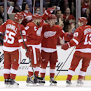 Detroit Red Wings' Gustav Nyquist (14), of Sweden, second from right, celebrates his first period goal against the Los Angeles Kings with teammates Niklas Kronwall (55), of Sweden, Henrik Zetterberg, of Sweden, and Pavel Datsyuk (13), of Russia, during an