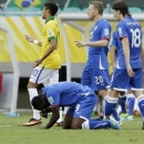 Italy forward Mario Balotelli (9) grimaces during the Confederations Cup group A soccer match between Italy and Brazil at Fonte Nova stadium in Salvador, Brazil, Saturday, June 22, 2013. Balotelli will miss Italy's semifinal game against Spain on Thursday due to a strained thigh. (AP Photo/Antonio Calanni)