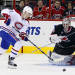 Montreal Canadiens' Lars Eller (81) moves the puck in front of Carolina Hurricanes goalie Cam Ward (30) during the second period of an NHL hockey game in Raleigh, N.C., Wednesday, Nov. 23, 2011