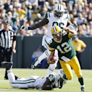 Green Bay Packers' Aaron Rodgers scrambles past New York Jets' Demario Davis (56) and Muhammad Wilkerson (96) during the first half of an NFL football game Sunday, Sept. 14, 2014, in Green Bay, Wis The Associated Press