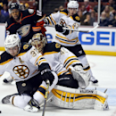 Boston Bruins center Patrice Bergeron helps goalie Tuukka Rask as he blocks a Anaheim Ducks shot during the second period of an NHL hockey game Monday, Dec. 1, 2014, in Anaheim, Calif The Associated Press