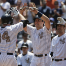 New York Yankees' Brian McCann (34) is greeted by Mark Teixeira after hitting a three-run home run against the Kansas City Royals during the first inning of a baseball game, Monday, May 25, 2015, in New York. (AP Photo/Julie Jacobson)