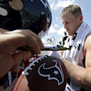 Houston Texans defensive end J.J. Watt signs autographs for fans after an NFL football training camp practice Sunday, July 27, 2014, in Houston The Associated Press