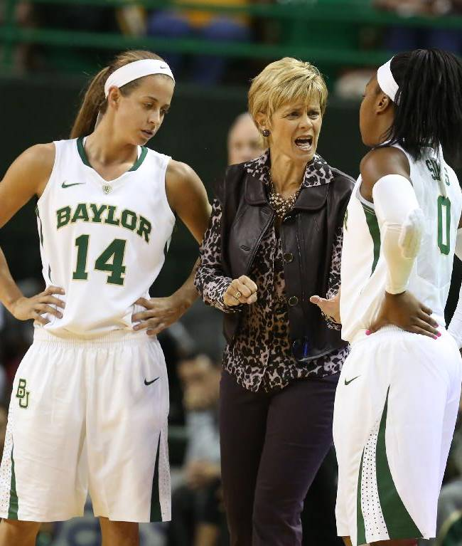Baylor coach Kim Mulkey, center, talks with Odyssey Sims, right, and Makenzie Robertson during a break in the first half of an NCAA college basketball exhibition game against Oklahoma City, Tuesday, Nov. 5, 2013, in Waco, Texas