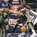 Memphis Grizzlies forward Zach Randolph, front right, tries to hand onto the ball under pressure from Utah Jazz guard Diante Garrett (8) and Marvin Williams, back right, in the second half of an NBA basketball game on Wednesday, March 19, 2014, in Memphis