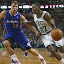 Boston Celtics guard Jordan Crawford (27) drives against Los Angeles Clippers forward Blake Griffin (32) in the first quarter of an NBA basketball game in Boston, Wednesday, Dec. 11, 2013 The Associated Press