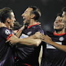 Austria's Manuel Ortlechner, third left, and his team mates celebrate after scoring during their Champions League play-off second leg match FK Austria Wien against GNK Dinamo Zagreb in Vienna, Austria, on Tuesday, Aug. 27, 2013. (AP Photo/Hans Punz)