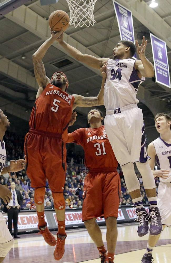 Nebraska guard Terran Petteway (5) shoots against Northwestern guard Sanjay Lumpkin (34) during the first half of an NCAA college basketball game in Evanston, Ill., Saturday, Feb. 8, 2014