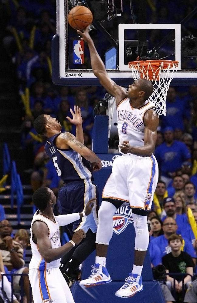 Oklahoma City Thunder forward Serge Ibaka (9) blocks a shot from Memphis Grizzlies guard Courtney Lee (5) during the third quarter of Game 1 of the opening-round NBA basketball playoff series in Oklahoma City on Saturday, April 19, 2014. Oklahoma City won 100-86