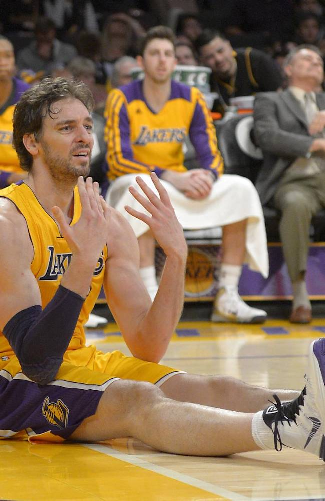 Los Angeles Lakers center Pau Gasol, of Spain, reacts after passing the ball to the wrong team from the floor during the second half of an NBA basketball game against the Cleveland Cavaliers, Tuesday, Jan. 14, 2014, in Los Angeles