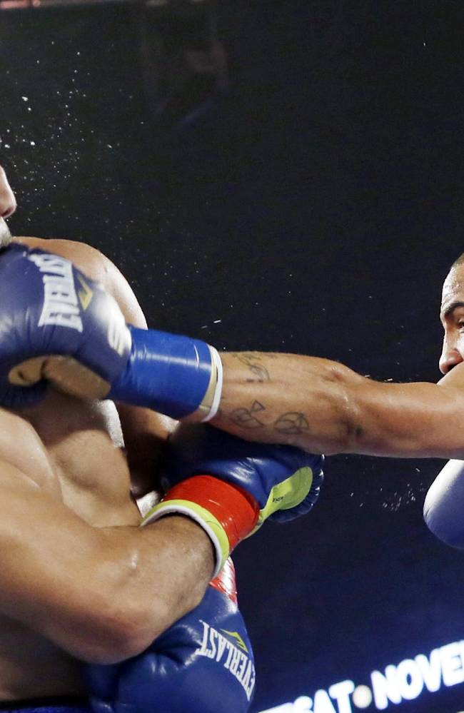 Andre Ward, right, lands a left to the head of Edwin Rodriguez, of the Dominican Republic, in the second round of their super middleweight championship boxing match in Ontario, Calif., Saturday, Nov. 16, 2013. Ward won by unanimous decision