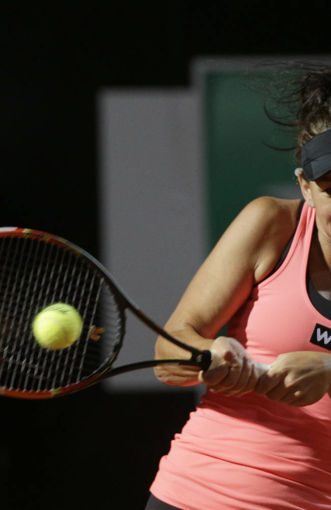 Australia's Casey Dellacqua returns the ball to China's Na Li  during their match at the Italian Open tennis tournament, in Rome, Tuesday, May 13, 2014