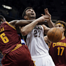 Milwaukee Bucks' Zaza Pachulia (27) is fouled as he tries to drive past Cleveland Cavaliers' Earl Clark (6) and Anderson Varejao (17) during the second half of an NBA basketball game Wednesday, Nov. 6, 2013, in Milwaukee The Associated Press