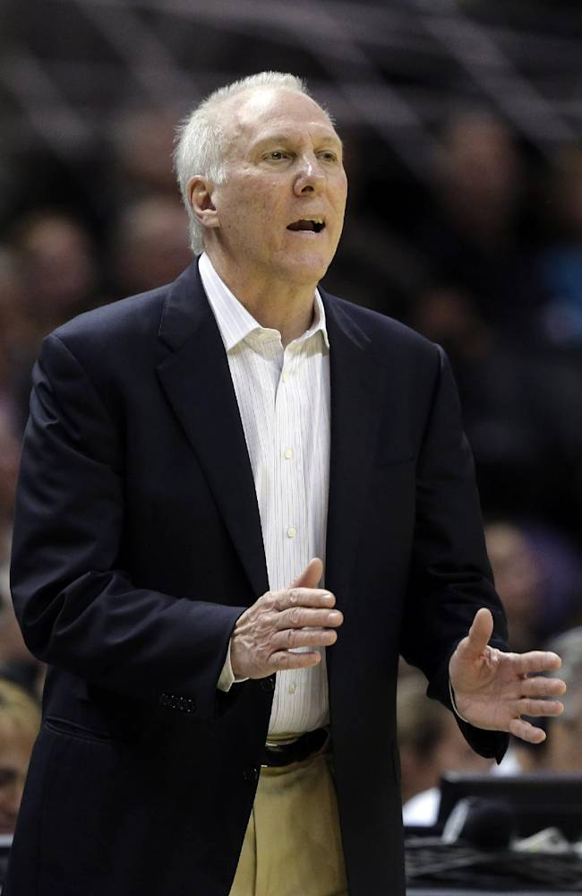 San Antonio Spurs coach Gregg Popovich talks to his players during the second half of an NBA basketball game against the Phoenix Suns, Wednesday, Nov. 6, 2013, in San Antonio. San Antonio won 99-96