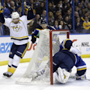 Nashville Predators' Mike Fisher, left, celebrates after scoring on St. Louis Blues goalie Brian Elliott, right, during the first period of an NHL hockey game Thursday, Jan. 29, 2015, in St. Louis The Associated Press