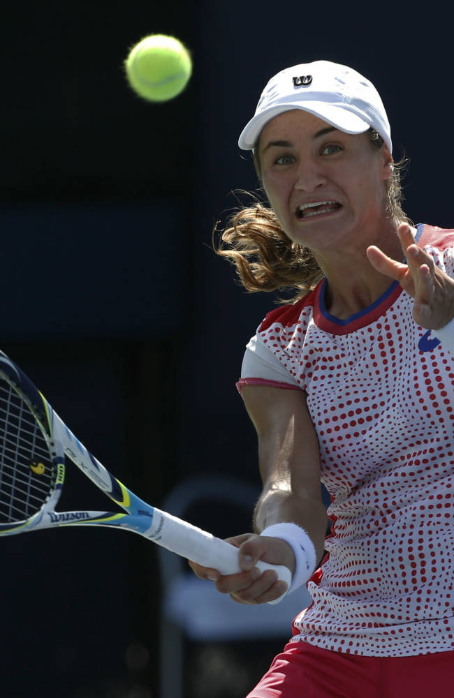 Monica Niculescu, of Romania, returns a shot against Barbora Zahlavova Strycova, of the Czech Republic, during the second round of the 2014 U.S. Open tennis tournament, Thursday, Aug. 28, 2014, in New York