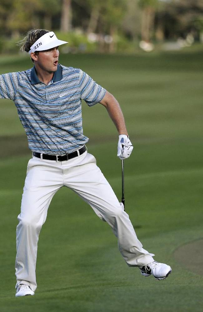 Russell Henley celebrates as he tied for the lead by chipping in for birdie on the 14th hole during the final round of the Honda Classic golf tournament, Sunday, March 2, 2014, in Palm Beach Gardens, Fla. Henley won the tournament after a four-man playoff