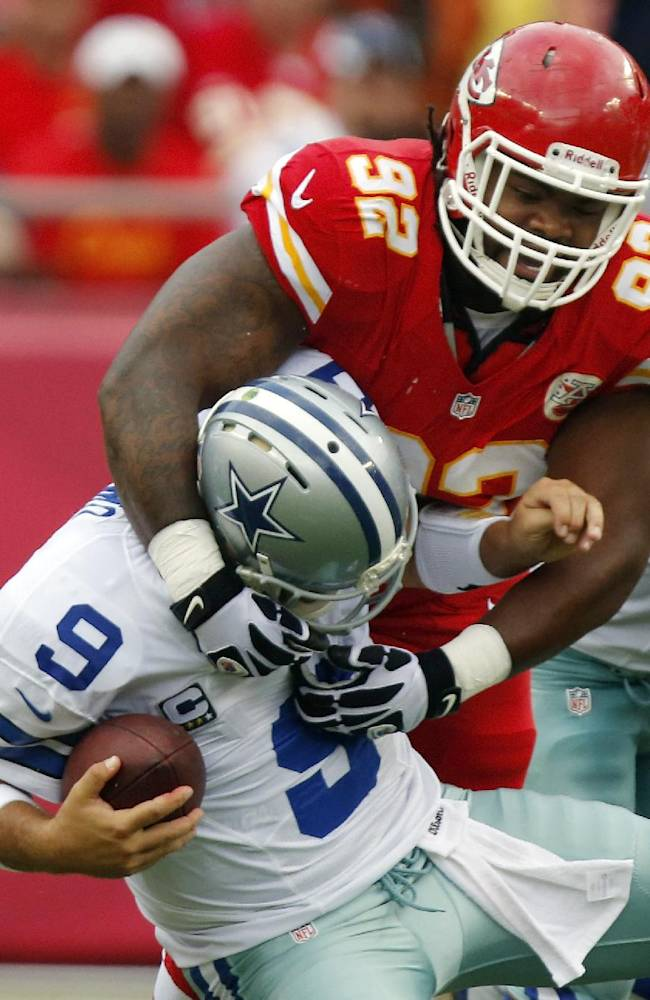 Dallas Cowboys quarterback Tony Romo (9) is sacked by Kansas City Chiefs nose tackle Dontari Poe (92) during the first half of an NFL football game at Arrowhead Stadium in Kansas City, Mo., Sunday, Sept. 15, 2013