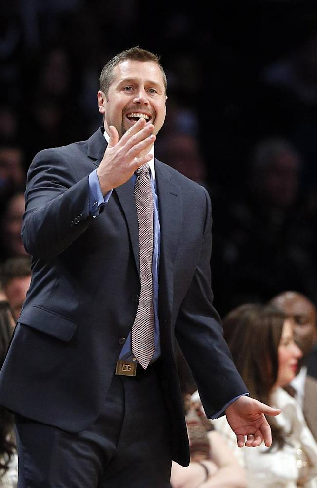 Memphis Grizzlies head coach David Joerger questions a call in the second half of an NBA basketball game against the Brooklyn Nets on Wednesday, March 5, 2014, in New York. Brooklyn won 103-94