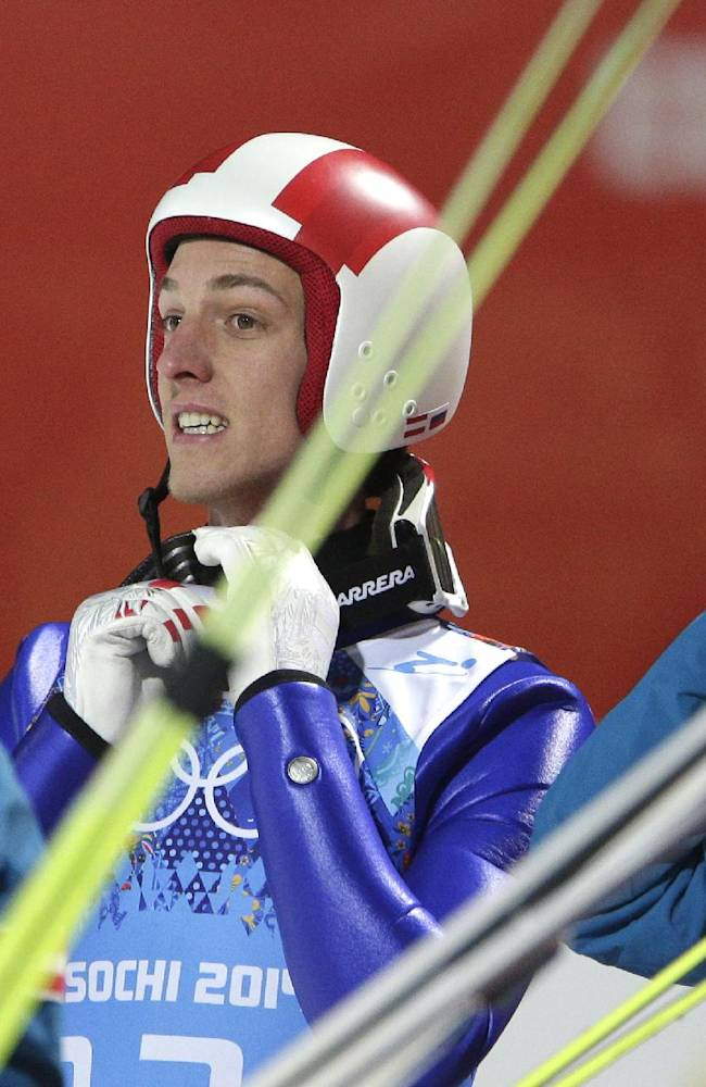 Austria's Gregor Schlierenzauer takes off his helmet as Austria takes the silver during the ski jumping large hill team competition at the 2014 Winter Olympics, Monday, Feb. 17, 2014, in Krasnaya Polyana, Russia