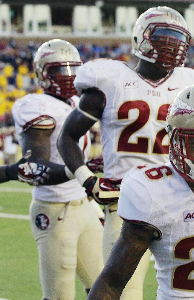 Florida State linebacker Nigel Terrell (28) celebrates after a pick-six with teammates during the second half of an NCAA college football game against Boston College in Boston, Mass., Saturday, Sept. 28, 2013. Florida State defeated Boston College 48-34