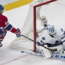Toronto Maple Leafs goaltender Jonathan Bernier makes a save against Montreal Canadiens' Daniel Briere during the third period of an NHL hockey game in Montreal, Saturday, March 1, 2014 The Associated Press