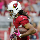 Arizona Cardinals wide receiver Larry Fitzgerald (11) warms up prior to an NFL football game against the Washington Redskins, Sunday, Oct. 12, 2014, in Glendale, Ariz The Associated Press