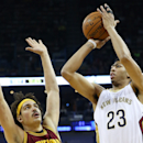 NEW ORLEANS, LA - DECEMBER 12: Anthony Davis #23 of the New Orleans Pelicans shoots the ball over Anderson Varejao #17 of the Cleveland Cavaliers at Smoothie King Center on December 12, 2014 in New Orleans, Louisiana. (Photo by Chris Graythen/Getty Images)