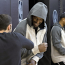 New Toronto Raptors player Patrick Patterson, center, is greeted by assistant coach Jesse Mermuys during a team practice in Toronto on Wednesday, Dec. 11, 2013 The Associated Press