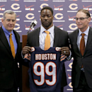 Chicago Bears general manager Phil Emery, left, poses with defensive end Lamarr Houston and head coach Marc Trestman after Houston was introduced as the newest member of the team during a news conference Wednesday, March 12, 2014, in Lake Forest, Ill The