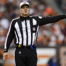 In this Dec. 16, 2012, file photo, NFL referee Bill Vinovich gestures during an NFL football game between the Cleveland Browns and the Washington Redskins in Cleveland. One momen Vinovich was lifting weights to stay in shape for the NFL season, the next h