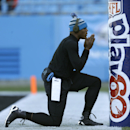 Carolina Panthers' Cam Newton pauses by a goal post as he warms up before an NFL football game against the Tampa Bay Buccaneers in Charlotte, N.C., Sunday, Dec. 1, 2013 The Associated Press