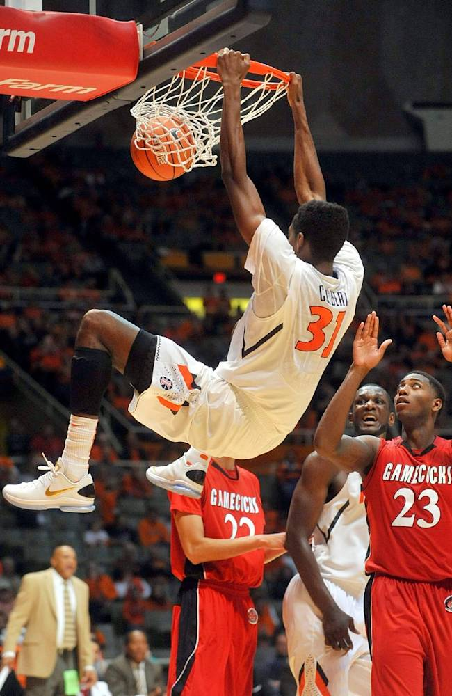 Illinois forward Austin Colbert (31) hangs on the net near Jacksonville State forward DJ Felder (23) during the first half of an NCAA college basketball game Sunday, Nov. 10, 2013, in Champaign, Ill