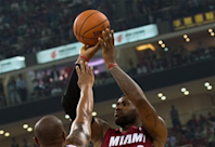 James leads Heat past Clippers in China