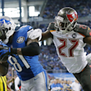 Detroit Lions wide receiver Calvin Johnson, defended by Tampa Bay Buccaneers cornerback Johnthan Banks (27), catches a 6-yard pass for a touchdown during the first half of an NFL football game in Detroit, Sunday, Dec. 7, 2014 The Associated Press