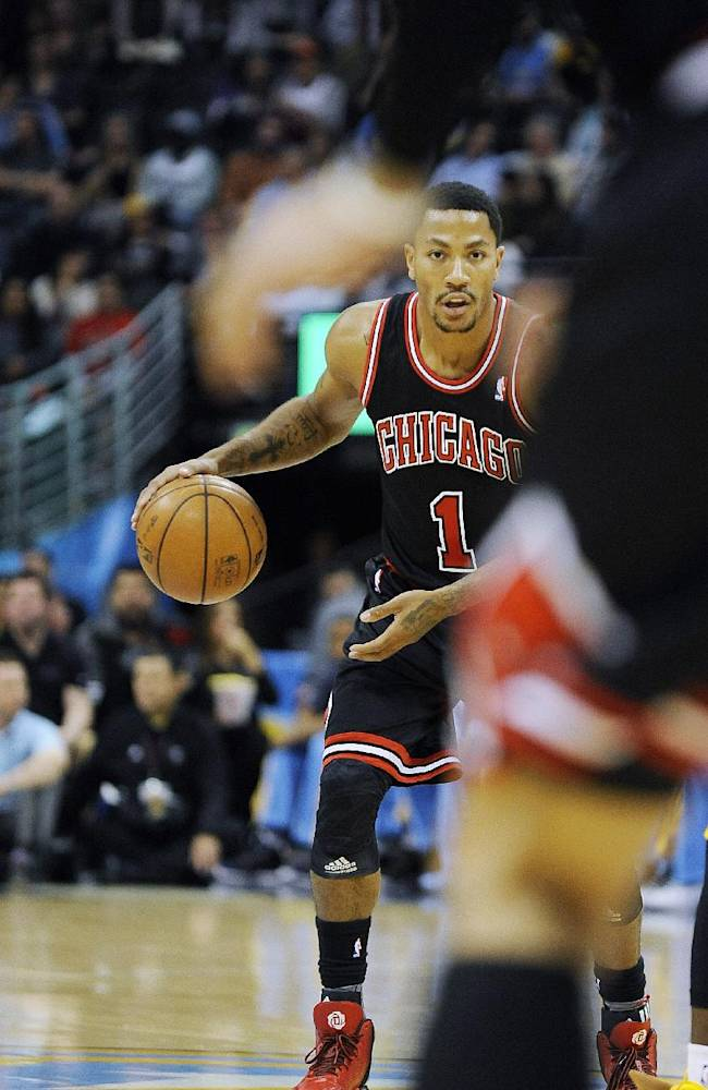 Chicago Bulls guard Derrick Rose brings the ball up the floor in the first quarter of an NBA basketball game against the Denver Nuggets on Thursday, Nov. 21, 2013, in Denver