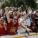Fans cheer as the Spanish national soccer team arrives for an exhibition soccer match against Haiti, Saturday, June 8, 2013 in Miami. (AP Photo/Lynne Sladky)